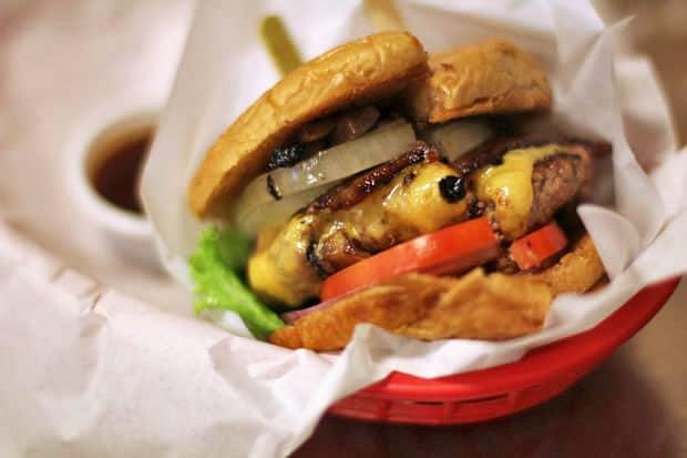 Beef Burger:  Charlie's Grind & Grill's San Miguel Beer BLACK ANGUS Cheeseburger