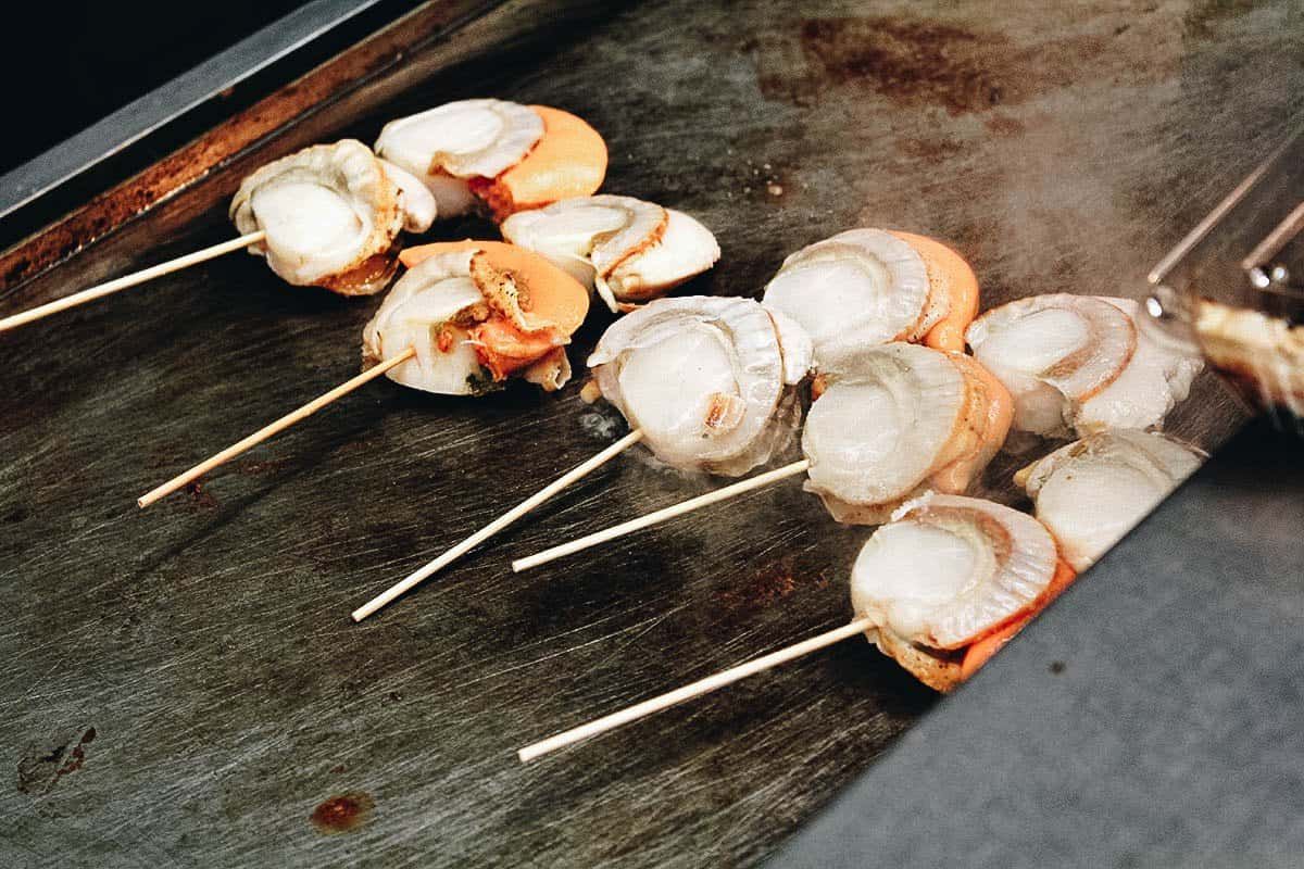 Grilled scallops at Kuromon Ichiba Market