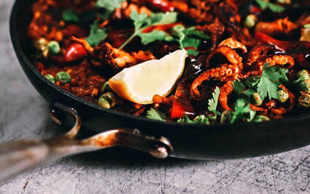 SPAIN: A Grotesquely Delicious Paella con Chorizo y Pulpo (Recipe)