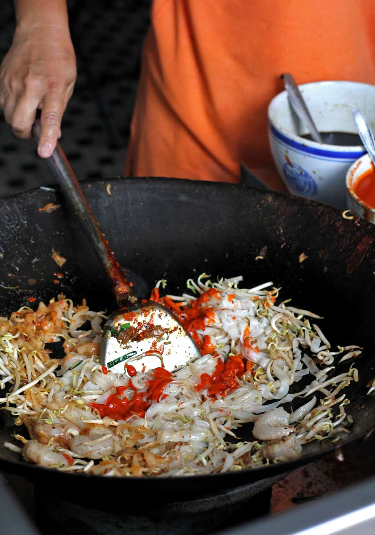 Cooking char koay teow in Penang, Malaysia