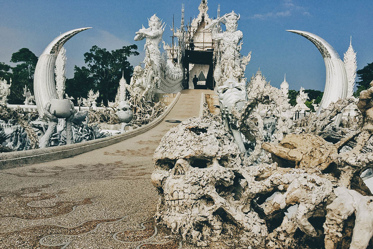 Explore Wat Rong Khun (White Temple), Baan Dam Museum (Black House), and Wat Rong Suea Ten (Blue Temple) in Chiang Rai, Thailand