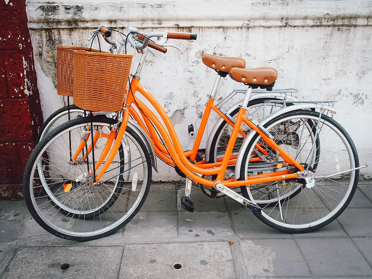 Orange bicycles with baskets