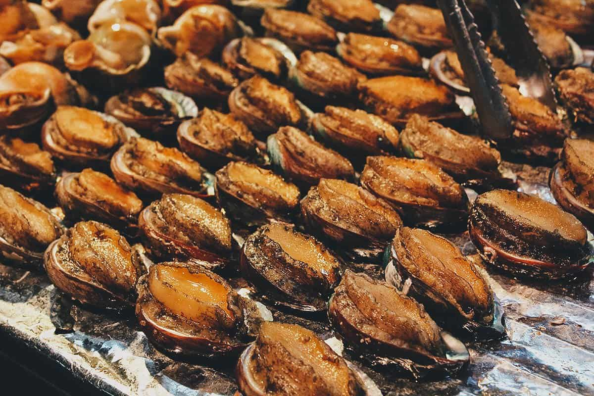 Grilled abalone at Fengjia Night Market in Taichung, Taiwan