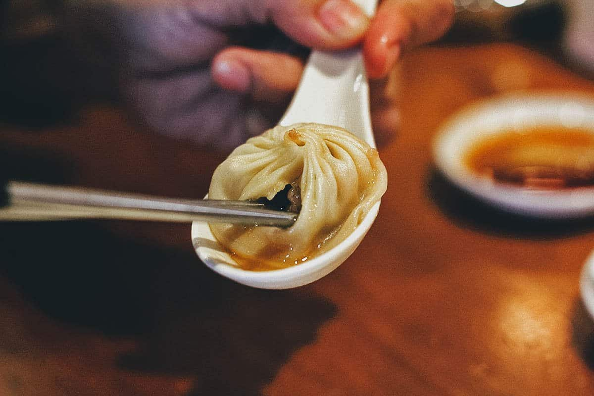 Piercing the skin of xiao long bao