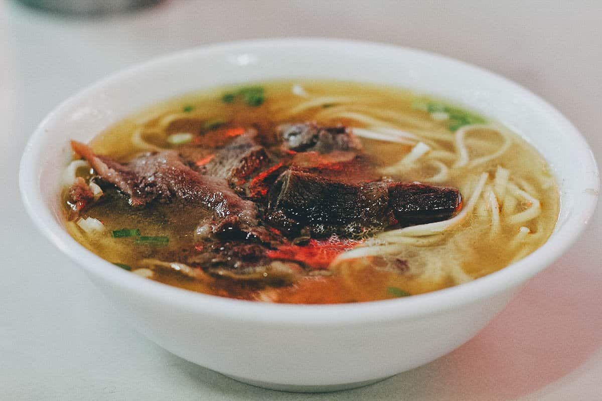 Bowl of clear beef noodle soup at Tao-Yuan Street Beef Noodle Shop in Taipei, Taiwan