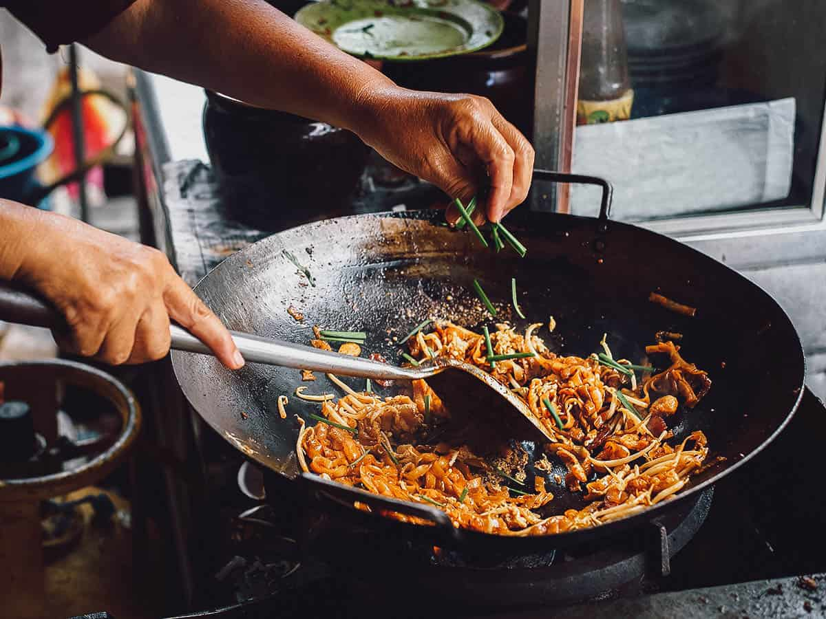 Cooking char koay teow in a wok