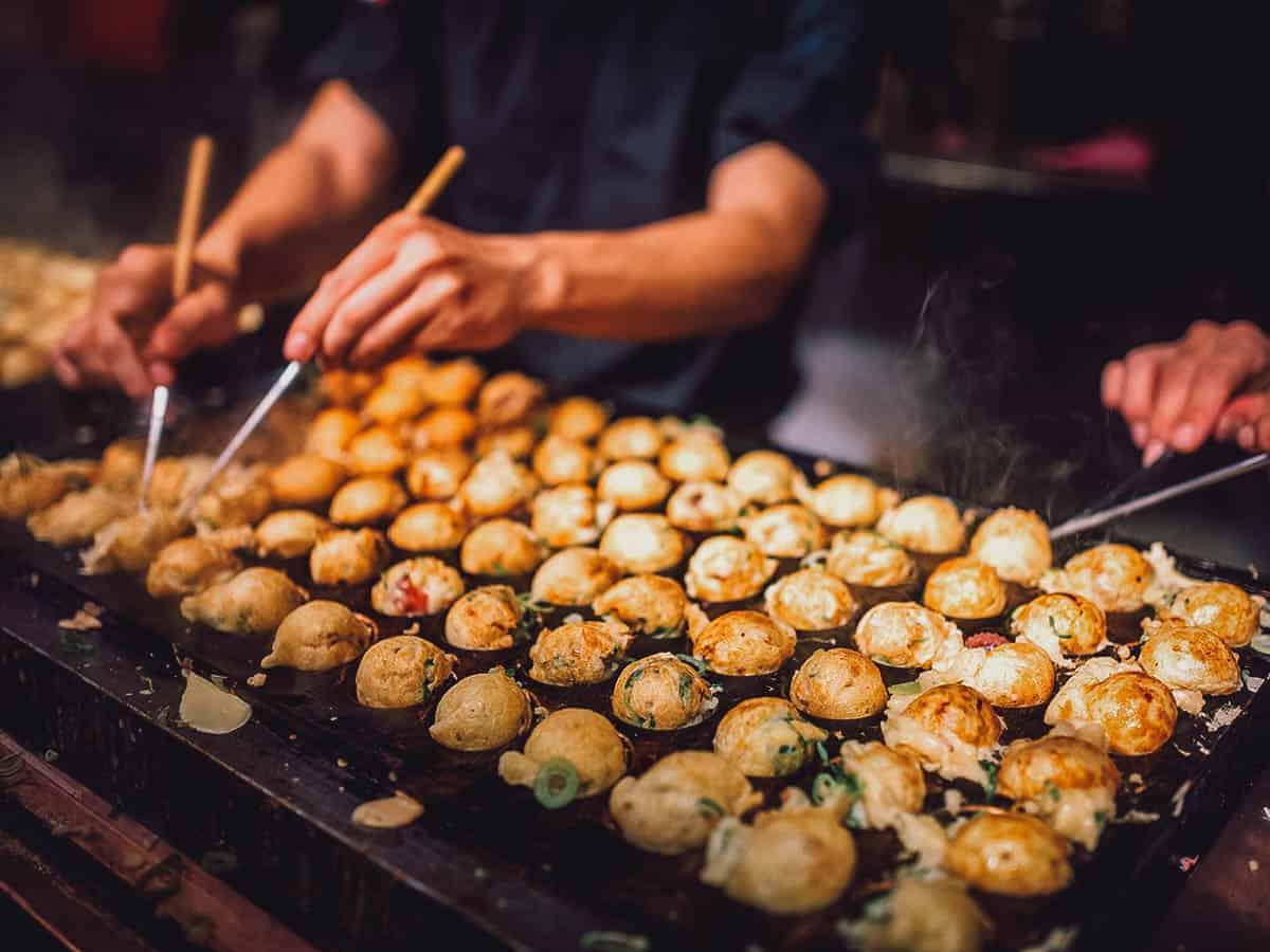 Street vendors cooking takoyaki balls