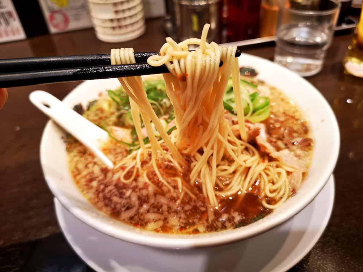 Showing off ramen noodles at Rai Rai Tei