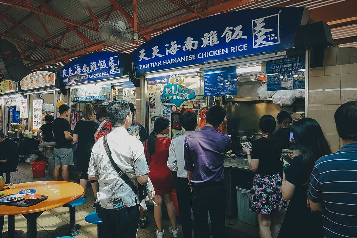 Long line of customers at Tian Tian Hainanese Chicken Rice