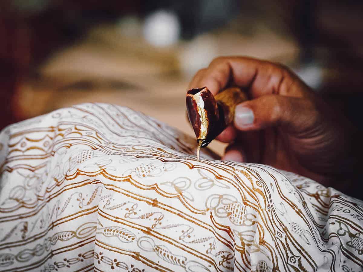 Painting batik pattern on fabric