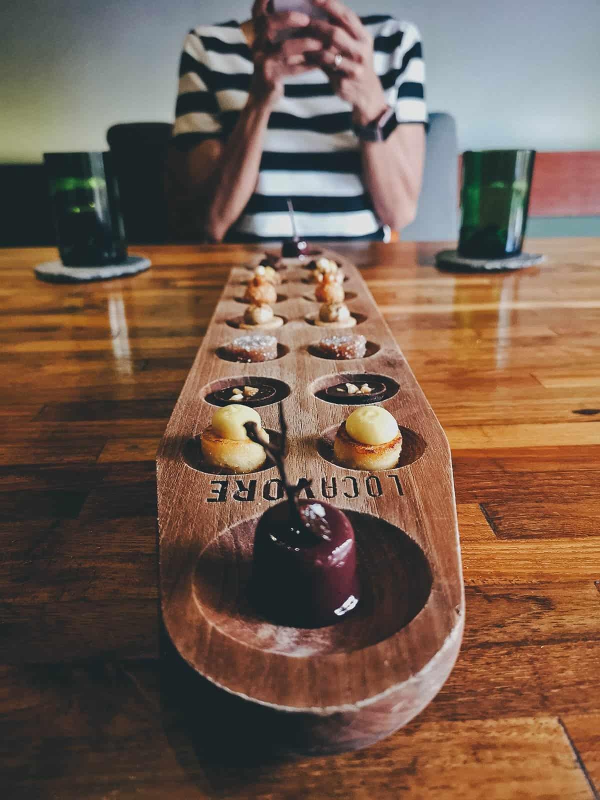 Dessert on a sungka board in Bali, Indonesia