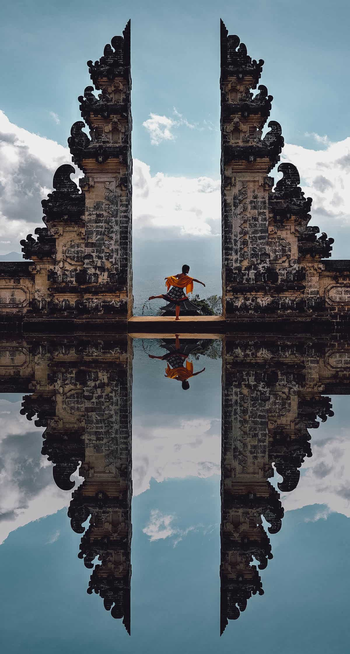 Woman posing at the Gate of Heaven in Bali