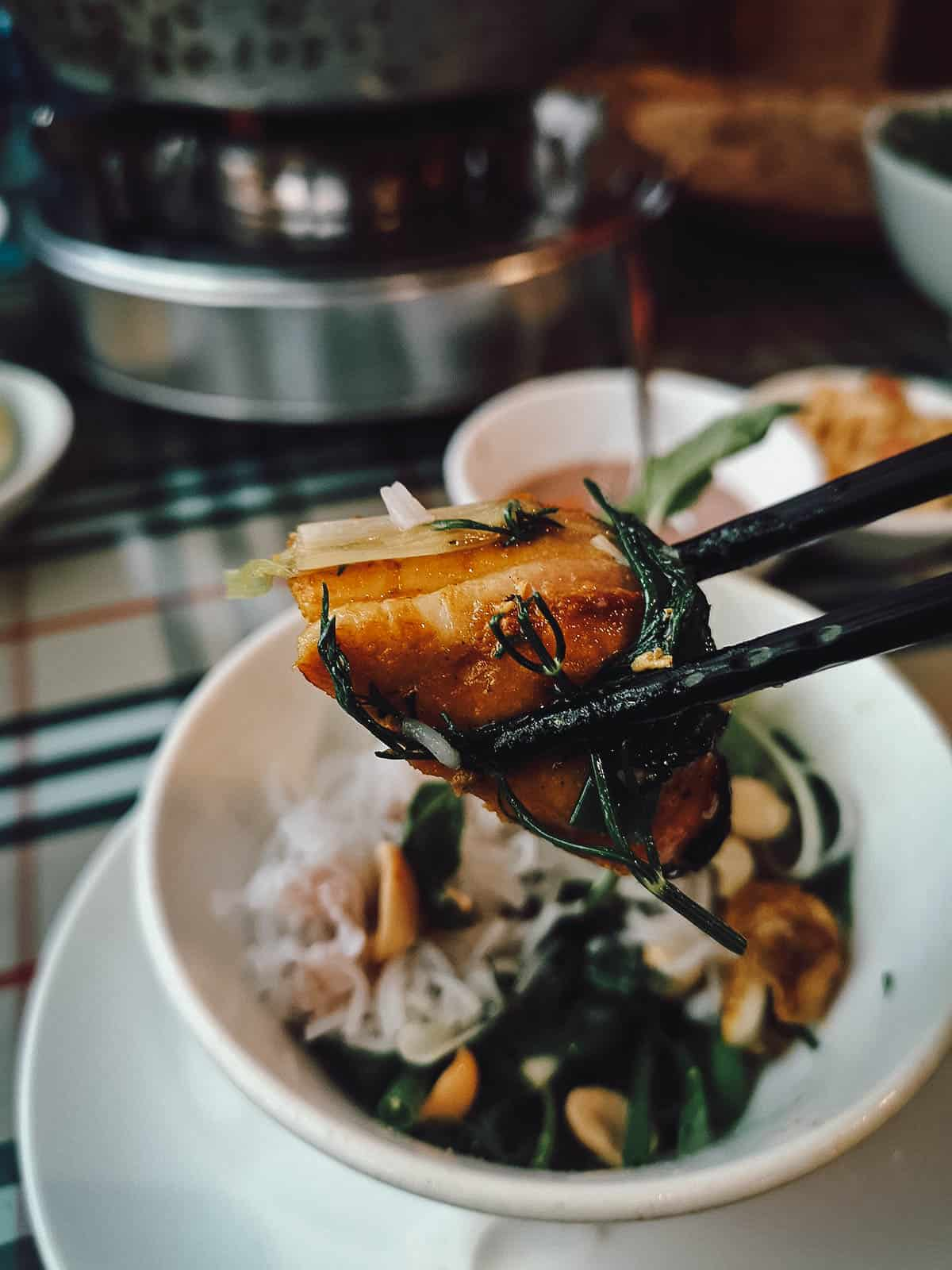 Getting ready to eat cha ca at Chả Cá Lão Ngư