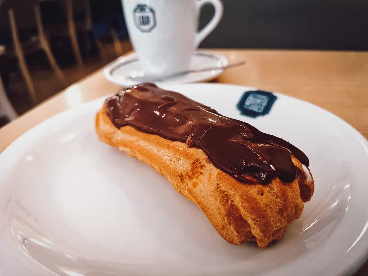 Chocolate eclair with coffee