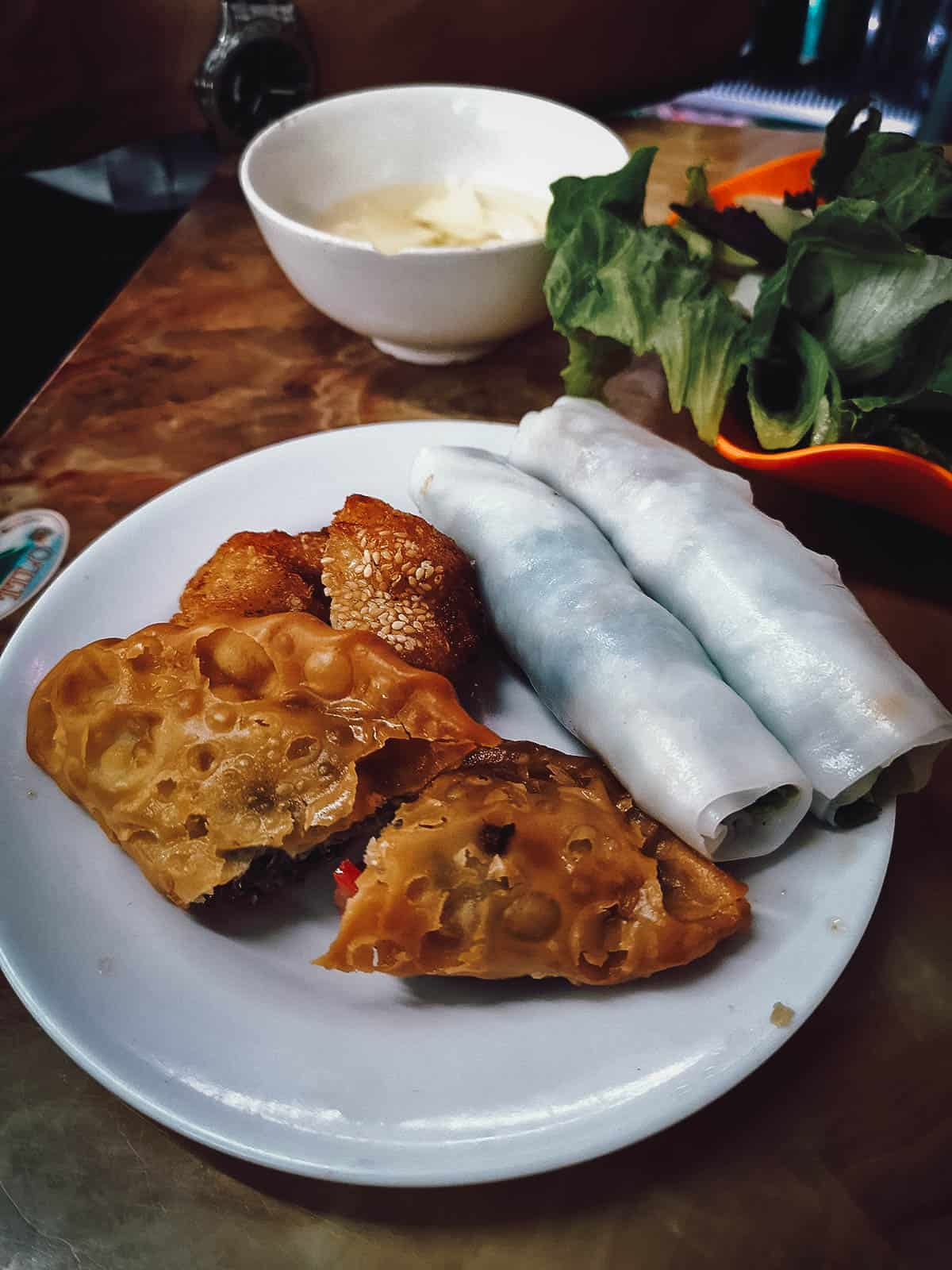 Deep-fried fritters and pho roll at Quán Gốc Đa
