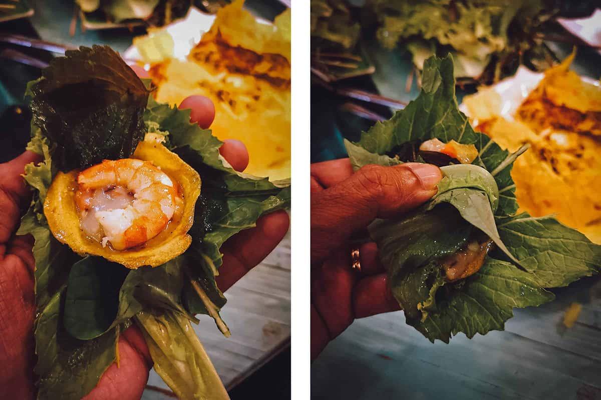Banh khot wrapped in lettuce leaves
