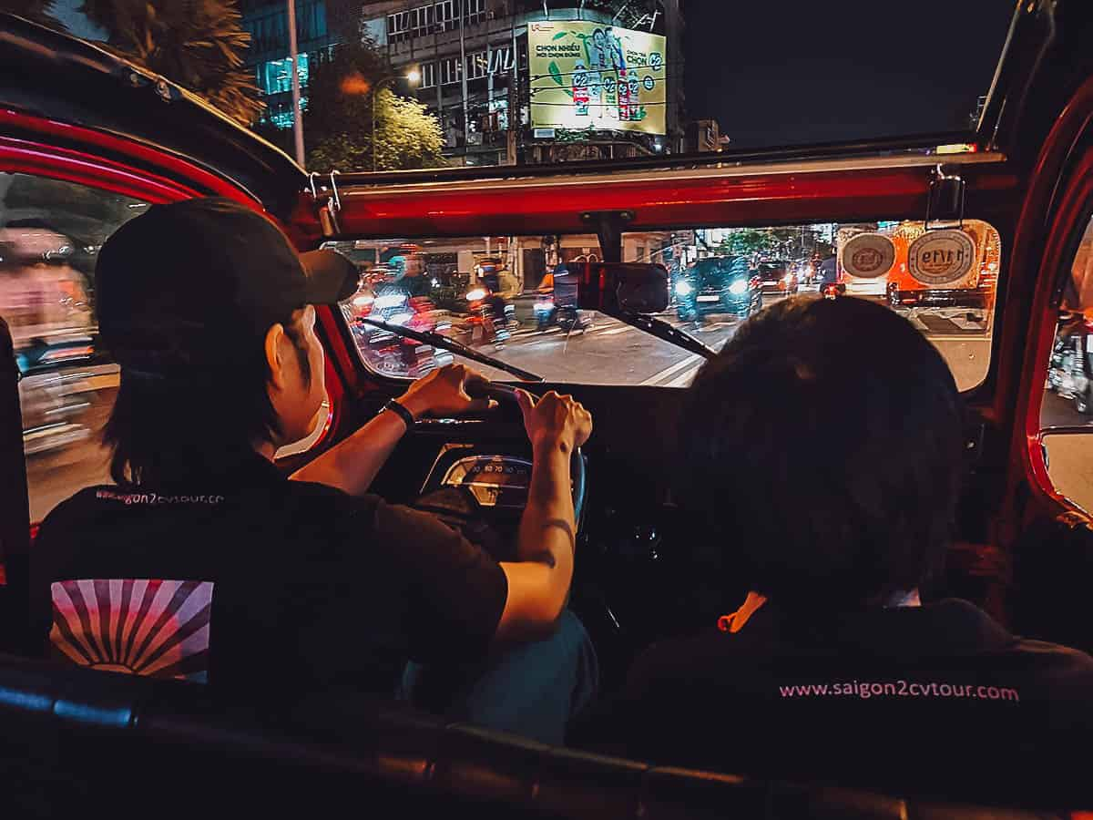 Driving in Saigon at night in a vintage Citroen 2CV in Saigon