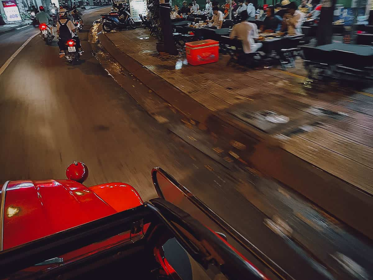 Driving in Saigon at night in a vintage Citroen 2CV in Saigon