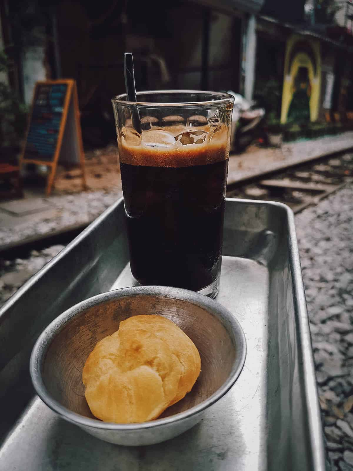 Black coffee and cream puff at The Railway Hanoi