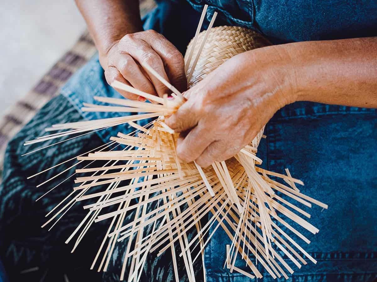 Woman weaving basket