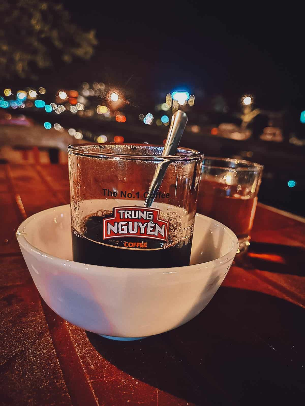 Black coffee by the river in Hoi An, Vietnam
