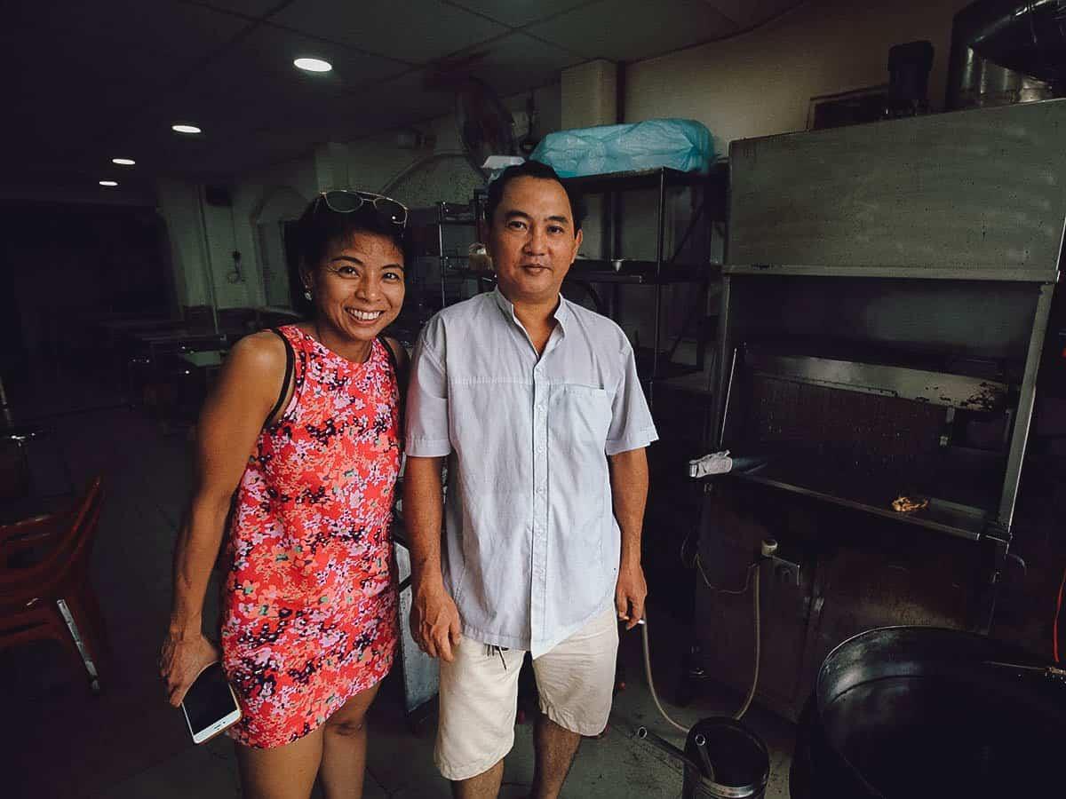 Ren standing with Com Ga Xoi Mo Su Su owner