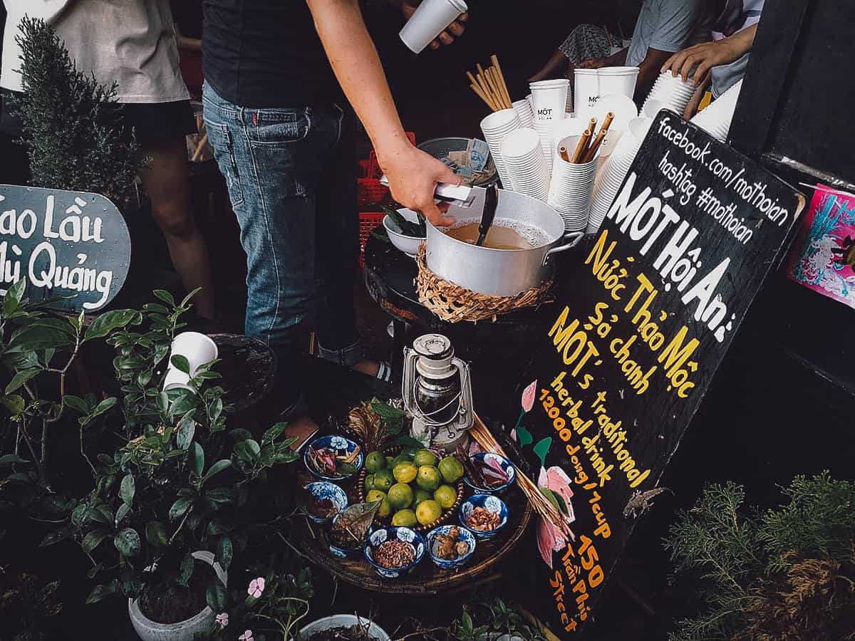 Man pouring herbal tea at Mot in Hoi An, Vietnam