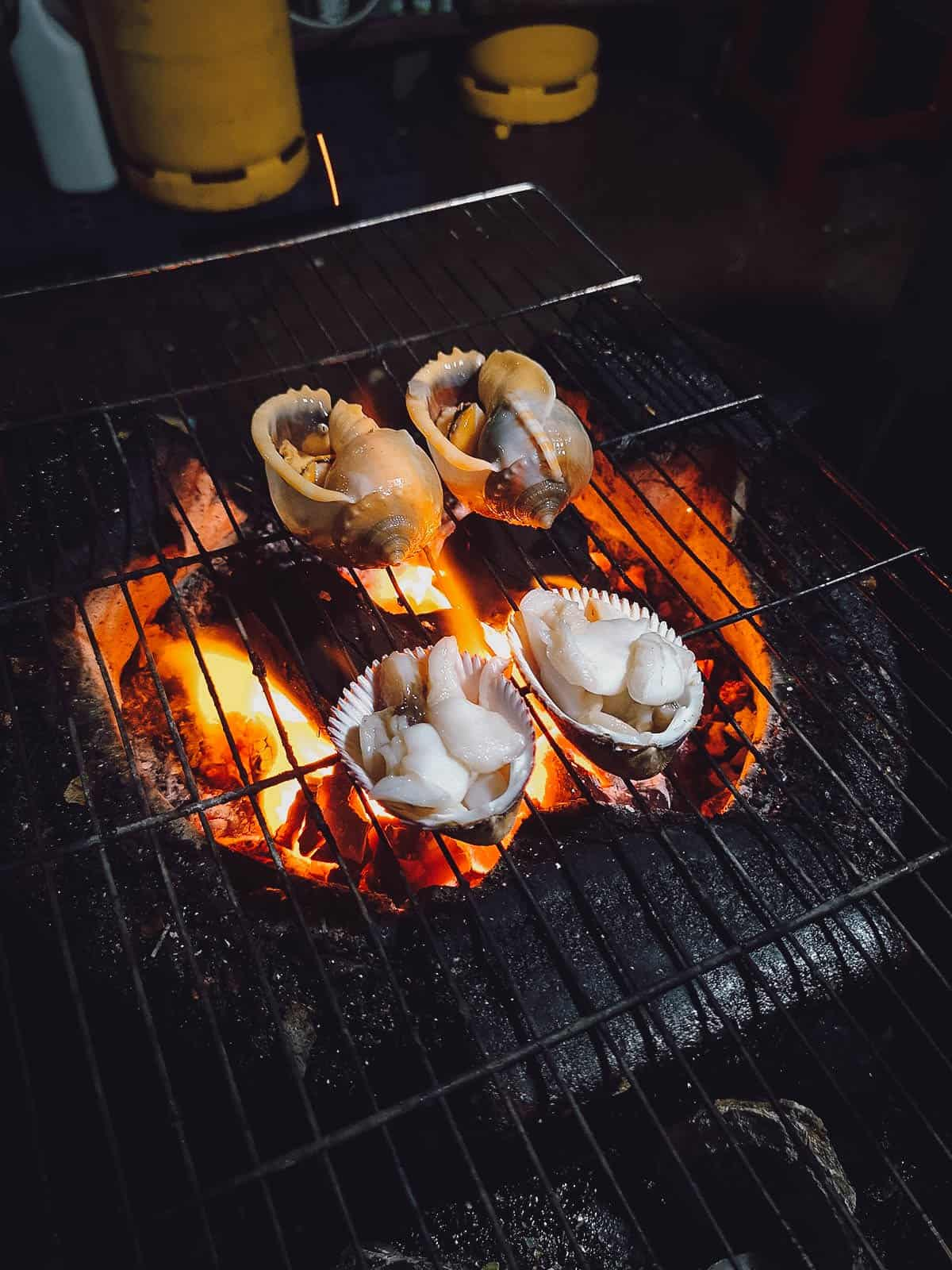 Grilling snails at Oc Loan