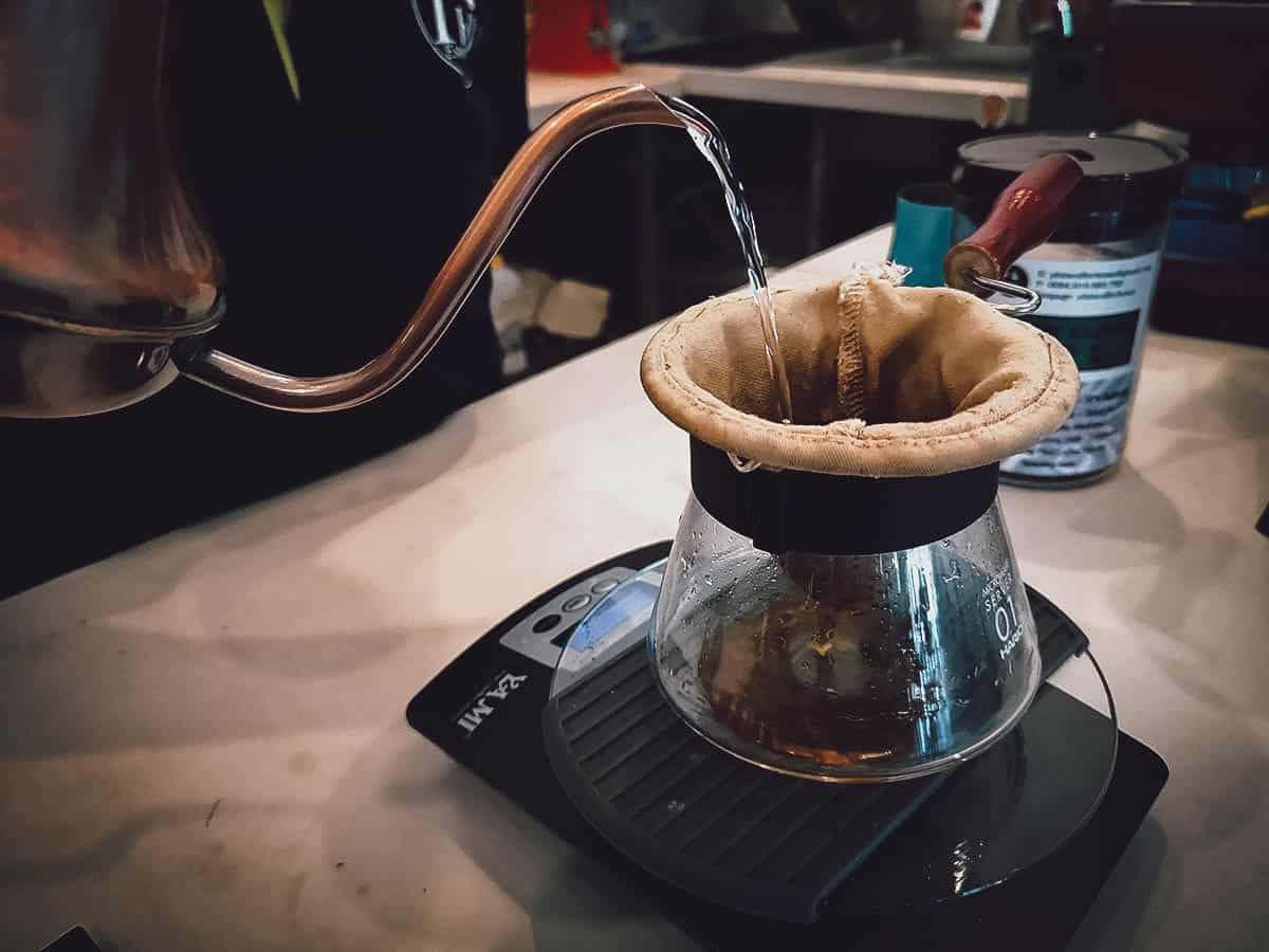 Brewing coffee at Phin Coffee in Hoi An, Vietnam