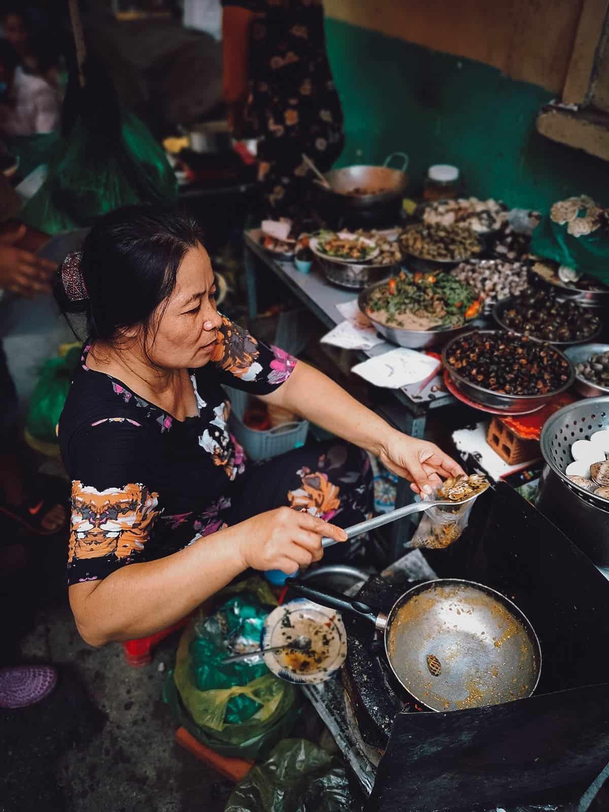 Snail lady in Ho Chi Minh City