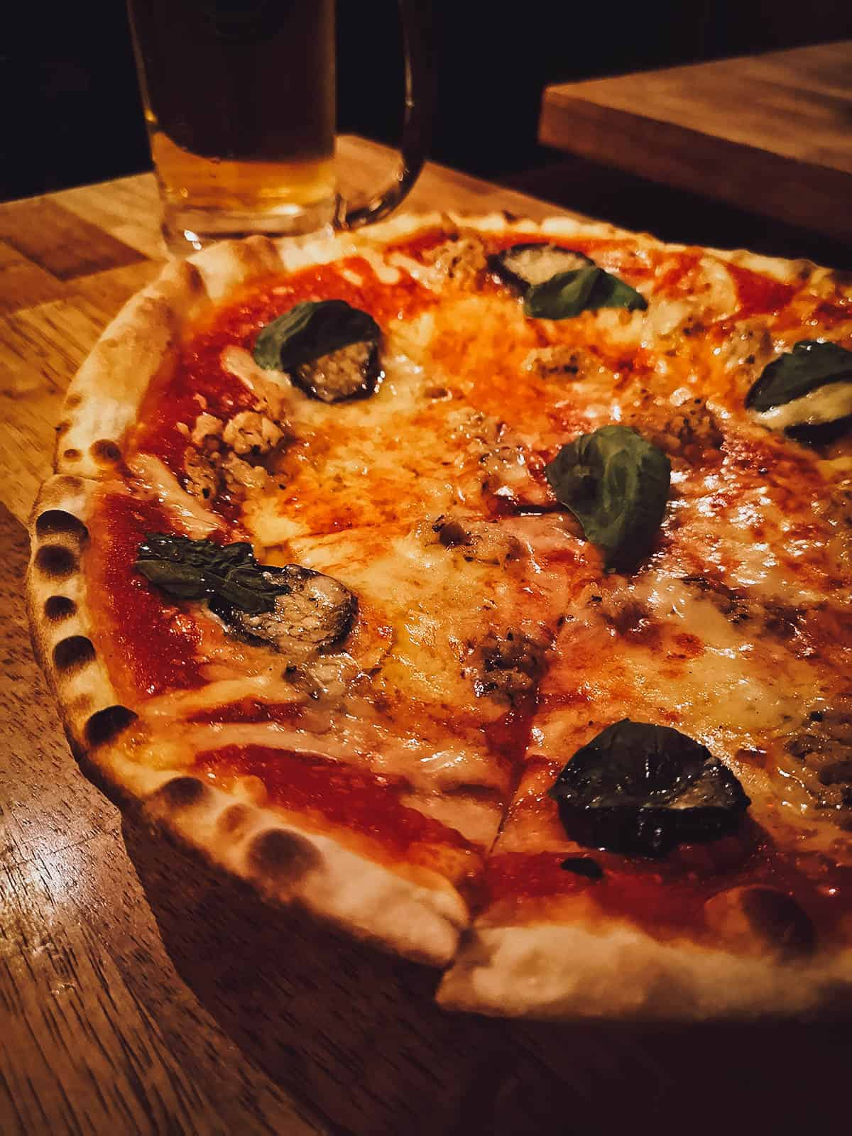 Pizza and beer at Ueno 500 Bar in Tokyo, Japan