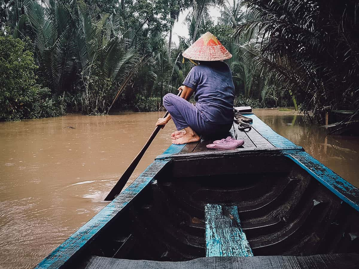 Riding a boat on the Mekong River