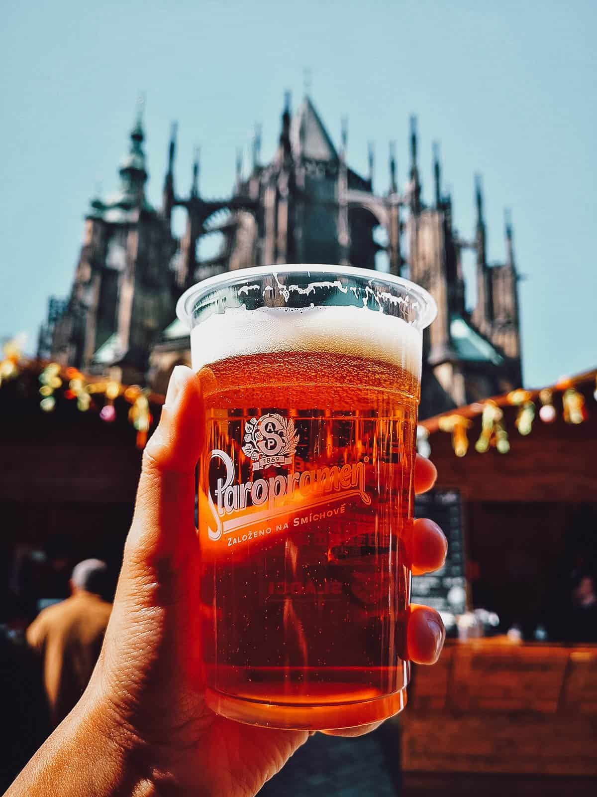 Drinking beer in front of St. Vitus Cathedral in Prague, Czech Republic