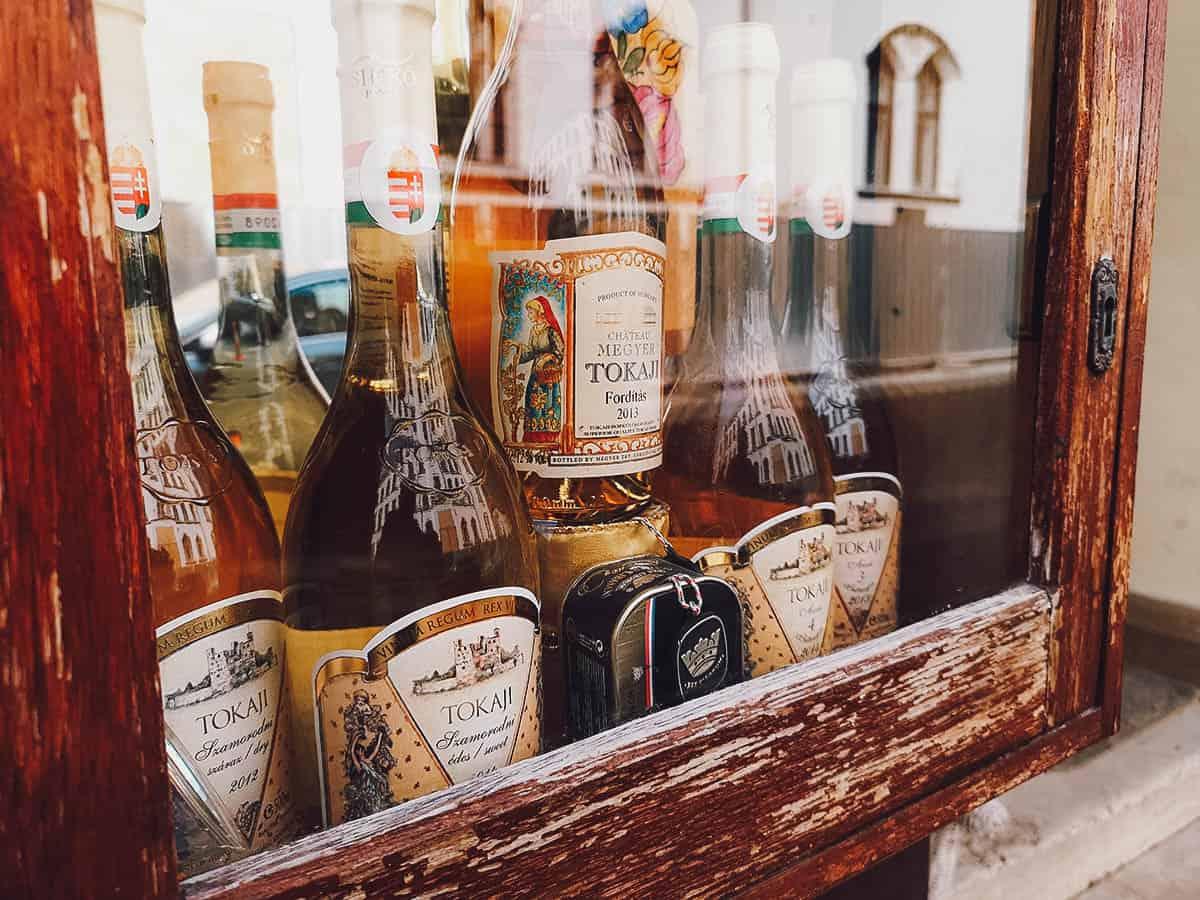 Bottles of tokaji behind a glass display