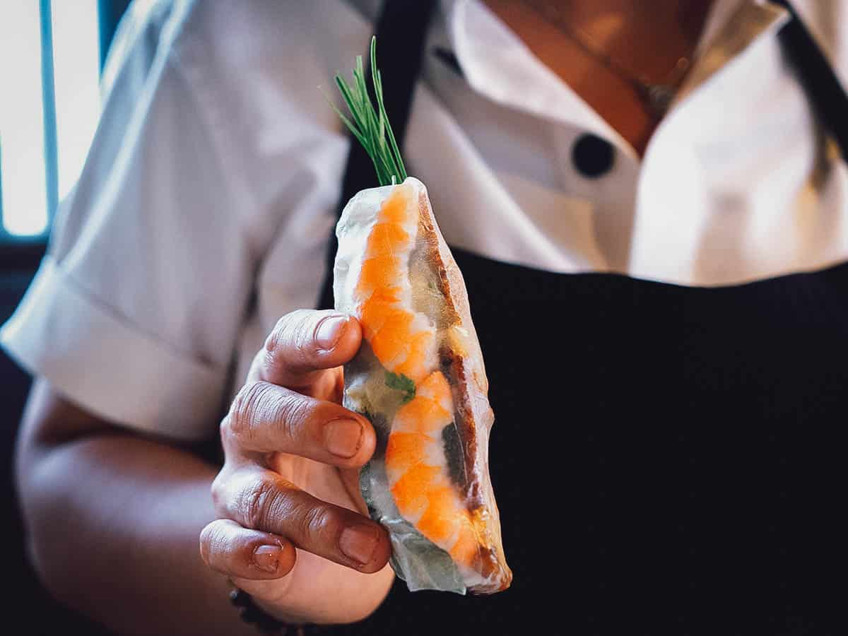 Woman holding a fresh spring roll