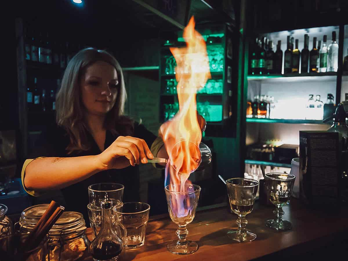 Bartender preparing absinthe drink at Absintherie in Prague, Czechia