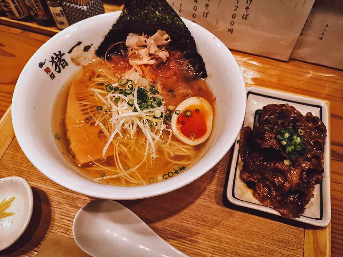 Bowl of ramen with a side of beef