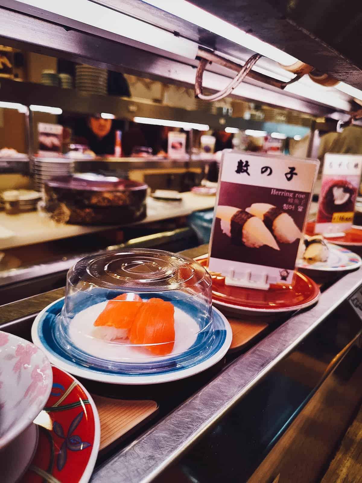 Sushi going around the conveyor belt