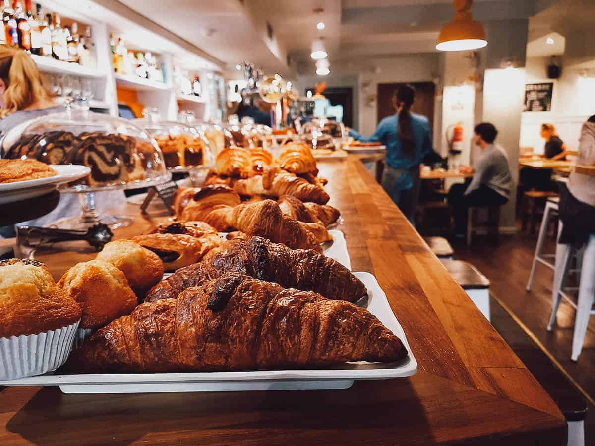 Pastries on counter and restaurant interior