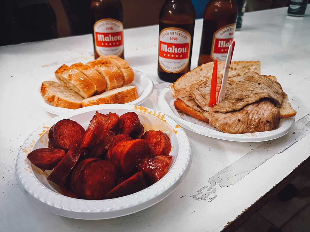 Lomo, chorizo, bread, and beer