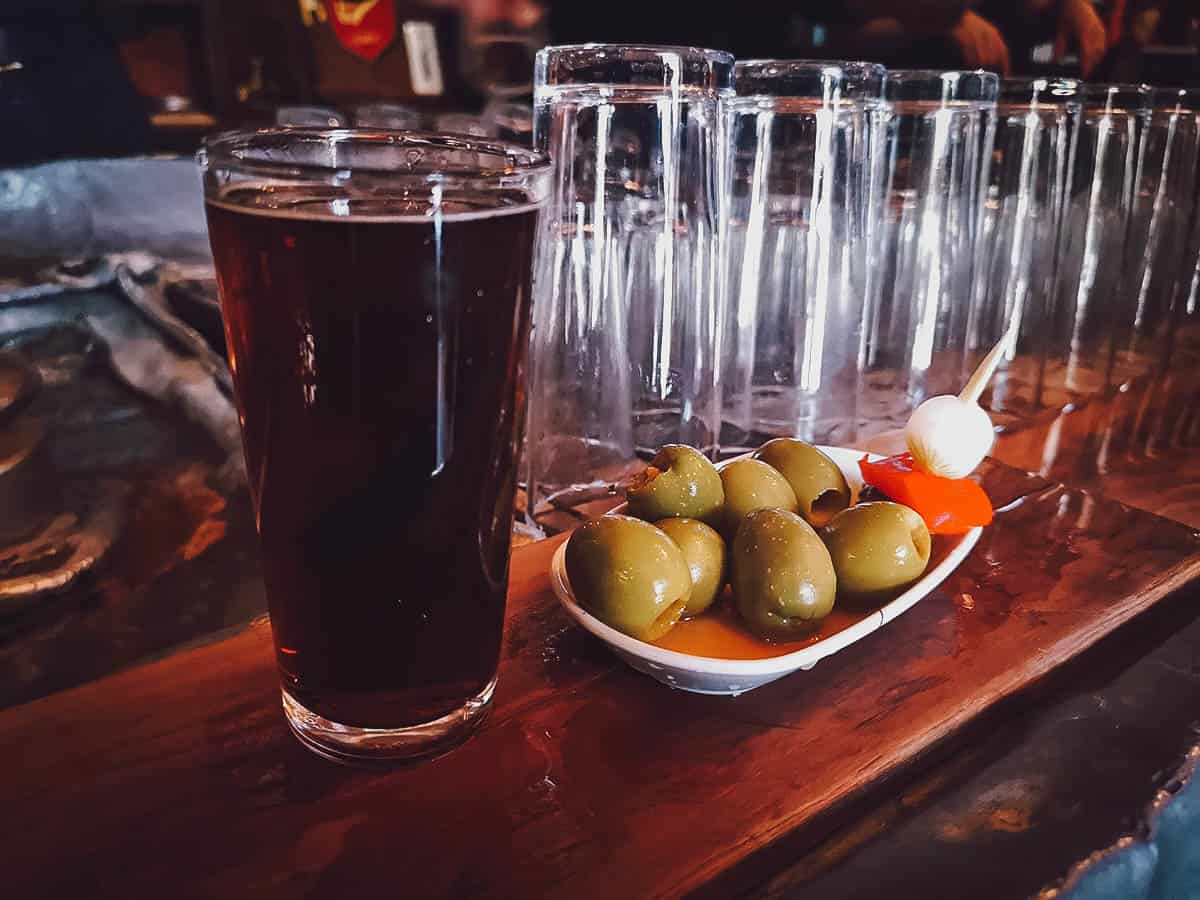 Glass of vermouth and olives