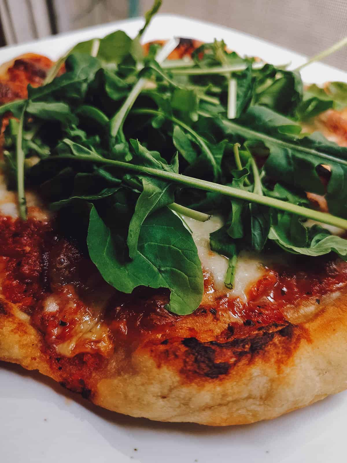 Neapolitan pizza topped with arugula