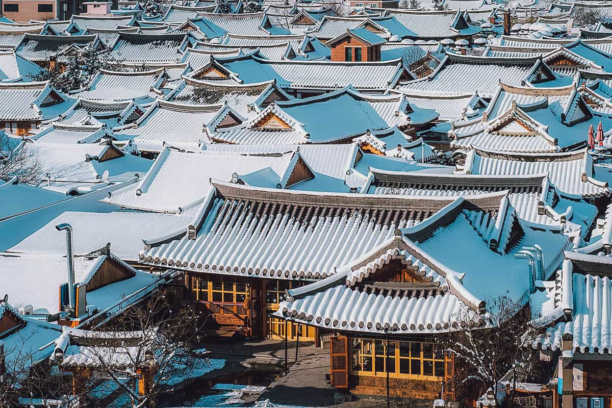 Traditional Korean houses covered in snow