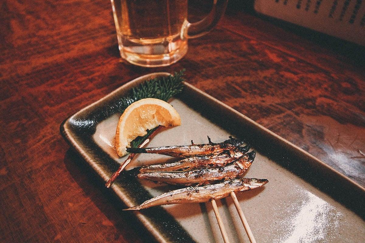 Skewered fish inside a yatai stall in Fukuoka