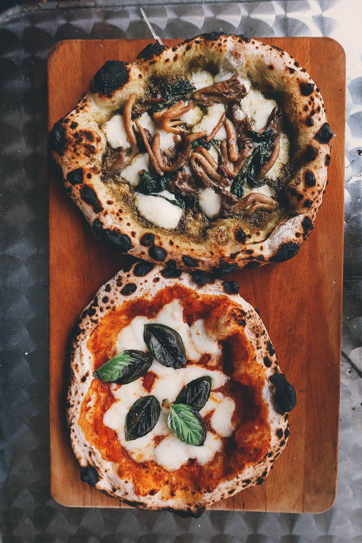 Two Neapolitan-style pizzas