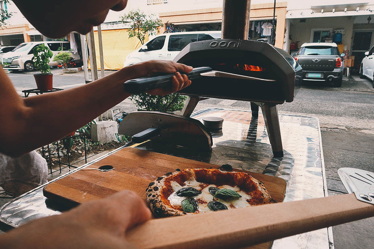 Cooking pizza in an Ooni pizza oven
