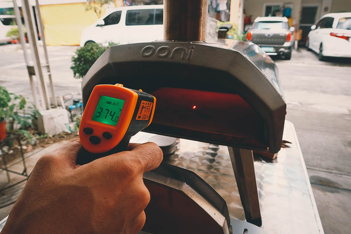 Checking the temperature of the pizza stone