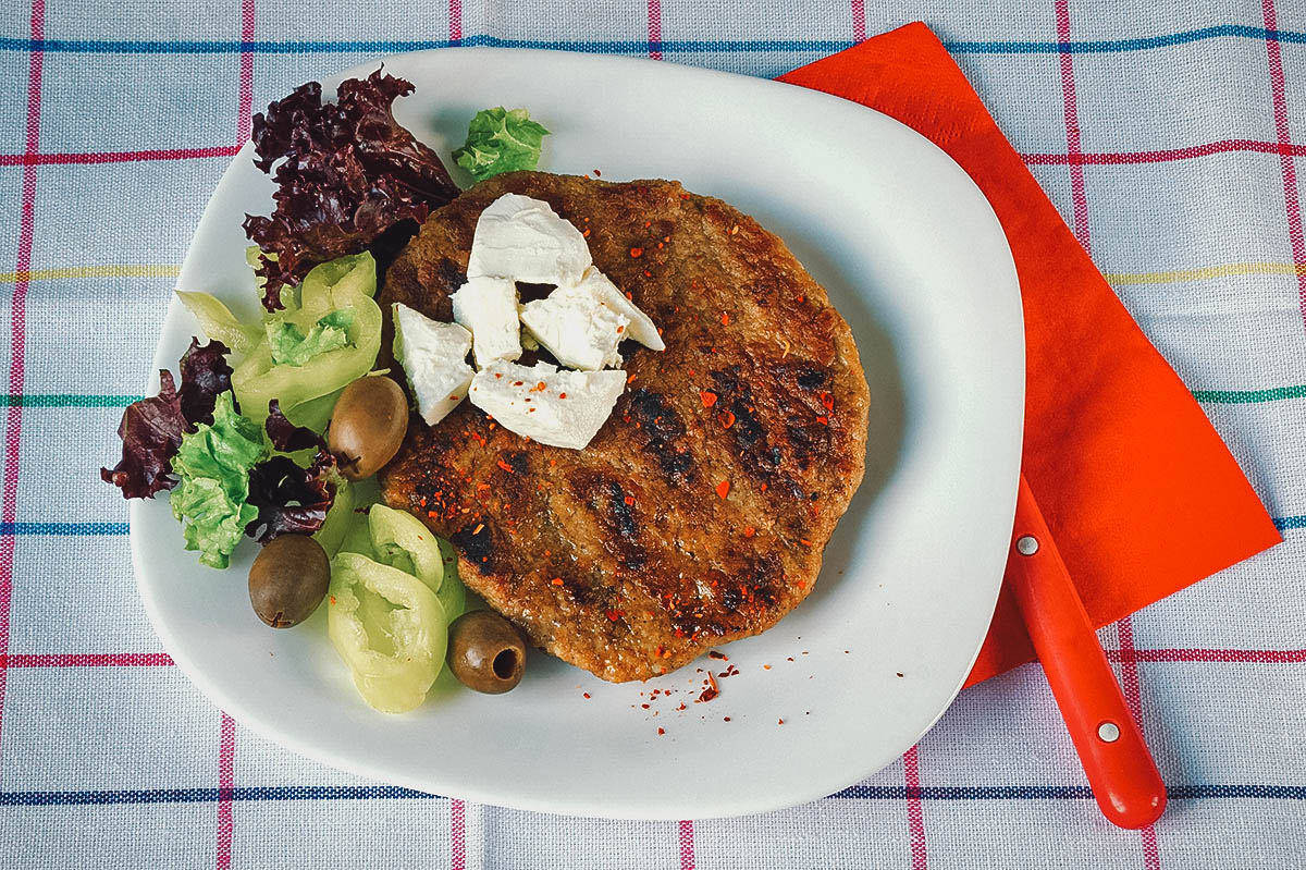 Pljeskavica with salad and cheese