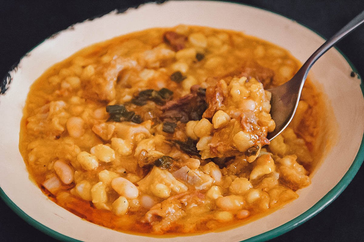 Bowl of locro with white corn, an Argentinian national dish