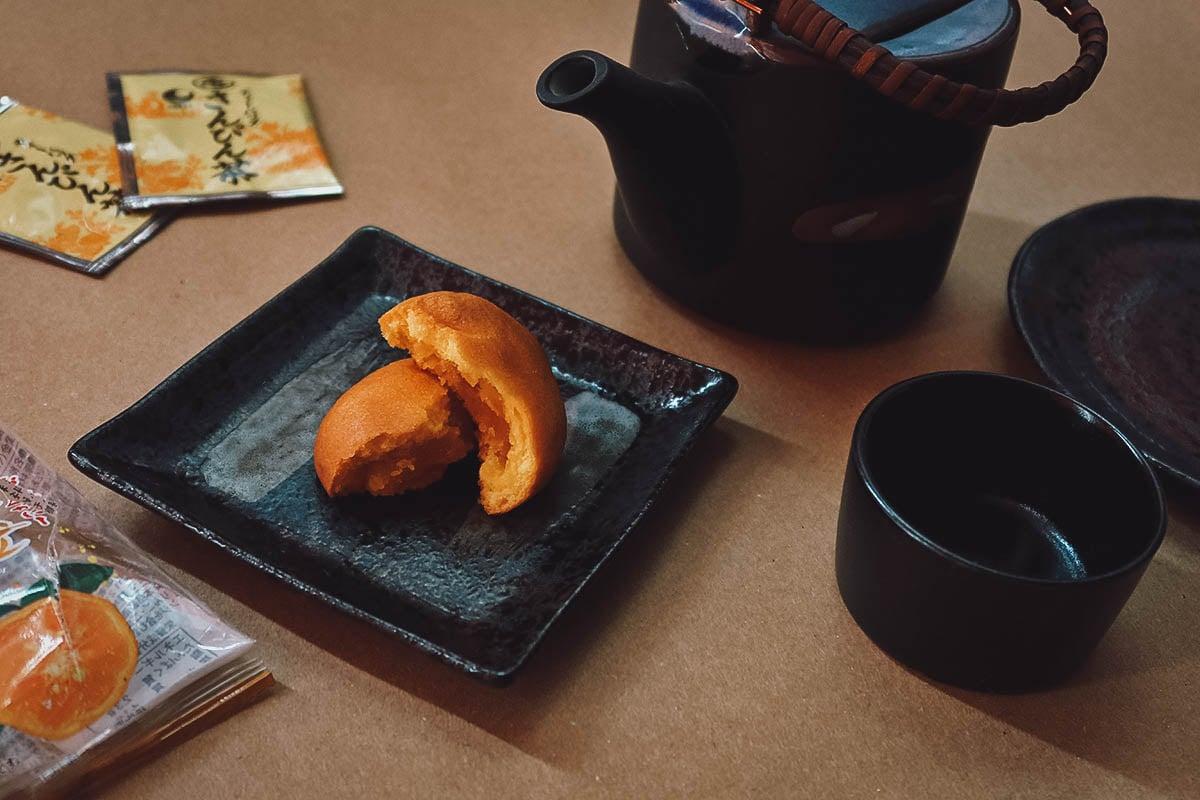 Kogane shikuwasa manju with Japanese teapot and plates